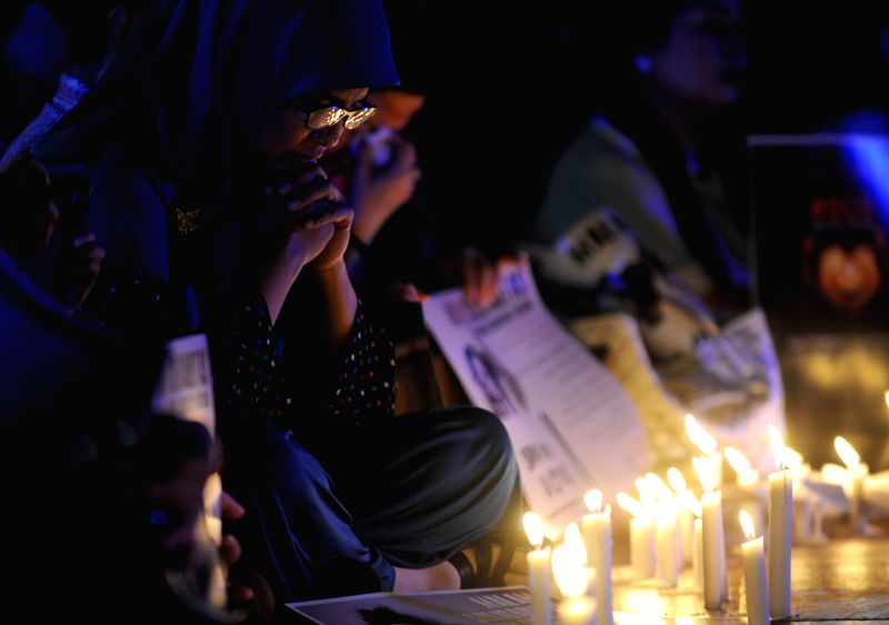 JAKARTA, May 13, 2016 - A woman attends a candle lightening rally to protest againts sexual violence in Jakarta, Indonesia, May 13, 2016. Sexual violence against children in Indonesia has reached to ...