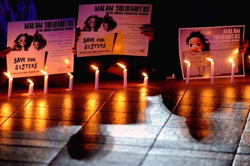 JAKARTA, May 13, 2016 - People attend a candle lightening rally to protest againts sexual violence in Jakarta, Indonesia, May 13, 2016. Sexual violence against children in Indonesia has reached to an ...
