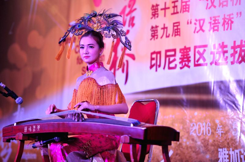 JAKARTA, May 15, 2016 - An Indonesian college student performs during a Chinese Bridge Proficiency Competition for foreign students in Jakarta, Indonesia, May 15, 2016.