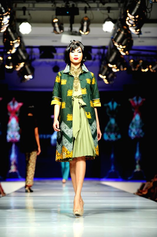 A model presents a creation by Indonesian designer Stephanus Hamy during Jakarta Fashion and Food Festival at Kelapa Gading in Jakarta, Indonesia, May 16, 2014. ...