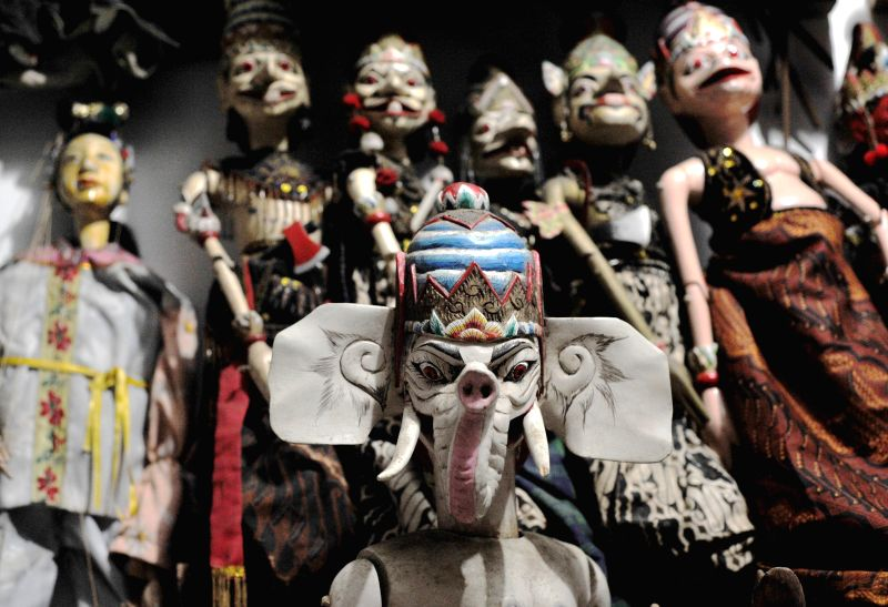 Wooden puppets are displayed at an art workshop at Sunter, in North Jakarta, Indonesia, May 16, 2014.