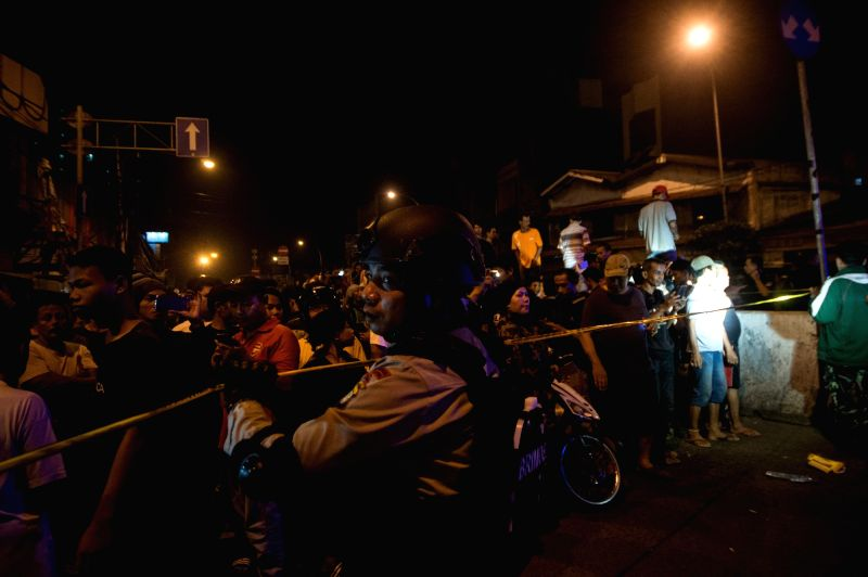 JAKARTA, May 25, 2017 - A policeman secures the bomb explosion location near a bus stop in Kampung Melayu, Jakarta, Indonesia on May 24, 2017. Three people were reported to be killed and some injured ...