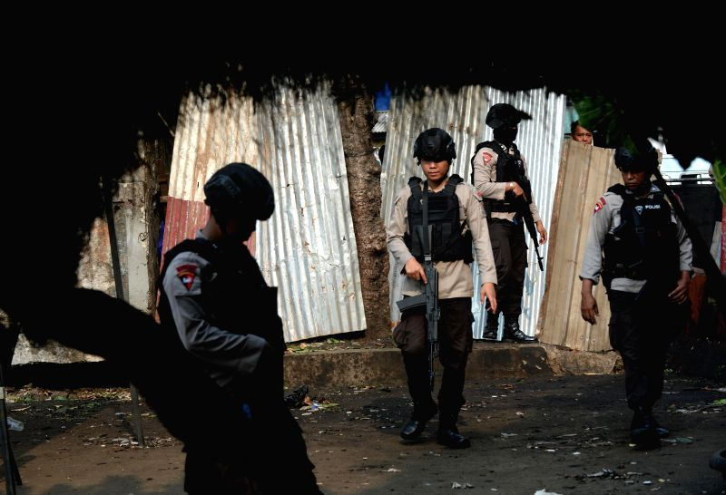JAKARTA, May 25, 2017 - Indonesian policemen stand guard at the explosion site after a suicide explosion near a bus stop in Kampung Melayu, Jakarta,  Indonesia, on May 25, 2017. Two were killed ...