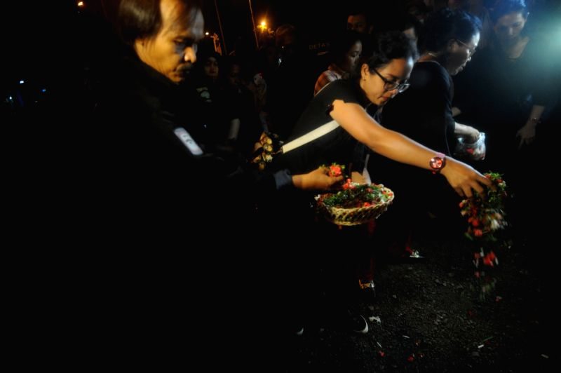 JAKARTA, May 25, 2017 - People lay flowers at the explosion site near a bus stop in Kampung Melayu, Jakarta, Indonesia, on May 25, 2017. Two were killed including a policeman in a suicide explosion ...