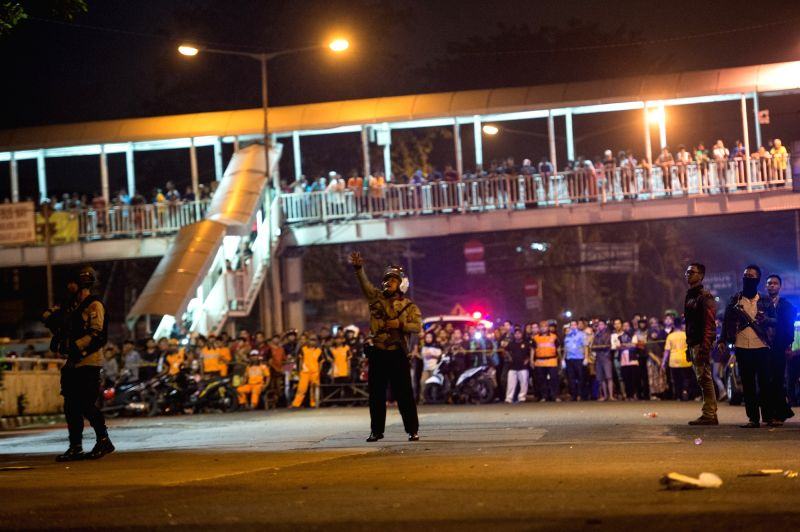 JAKARTA, May 25, 2017 - Police secure the bomb explosion location near a bus stop in Kampung Melayu, Jakarta, Indonesia on May 24, 2017. Three people were reported to be killed and some injured as ...