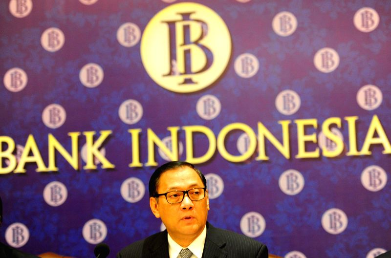 Photo: Indonesia's Central Bank Governor Agus Martowardojo attends a press conferences in Jakarta, Indonesia, May 8, 2014. The Indonesian central bank on Thursday ...