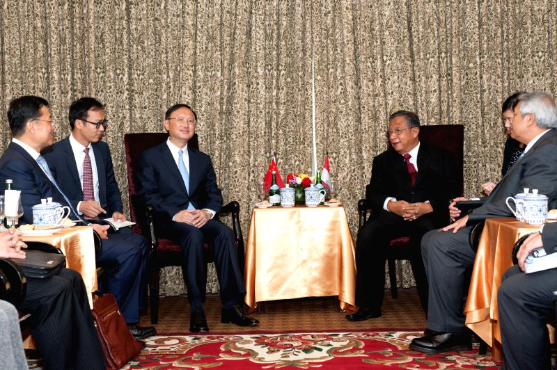 JAKARTA, May 9, 2016 - Chinese State Councilor Yang Jiechi (3rd L) speaks with Darmin Nasution, Indonesian Coordinating Minister for Economic Affairs (4th L), during a welcoming bilateral meeting of ...