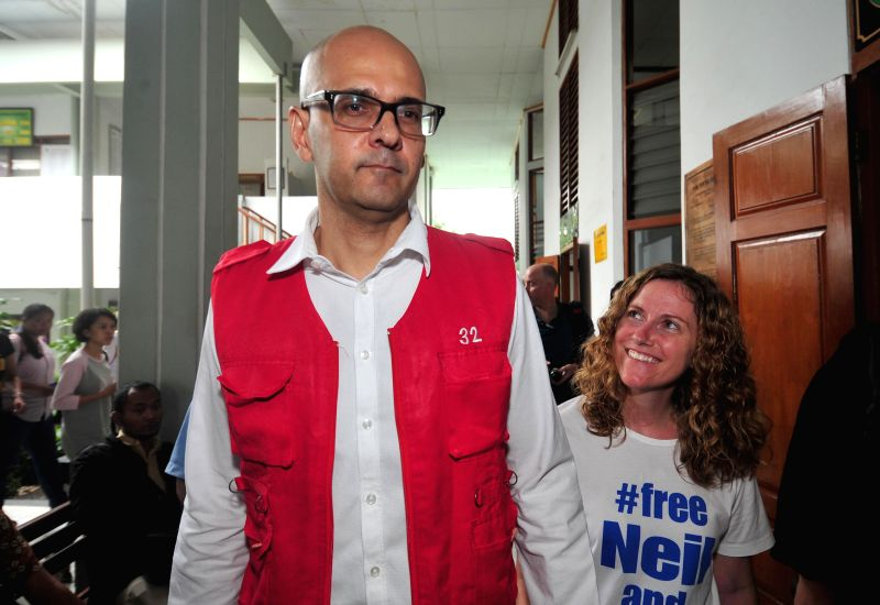 Neil Bantleman (L) accompanied by his wife walks out from a court after first trial in Jakarta, Indonesia, Dec. 2, 2014. Bantleman, who worked at a prestigious Jakarta International School, .