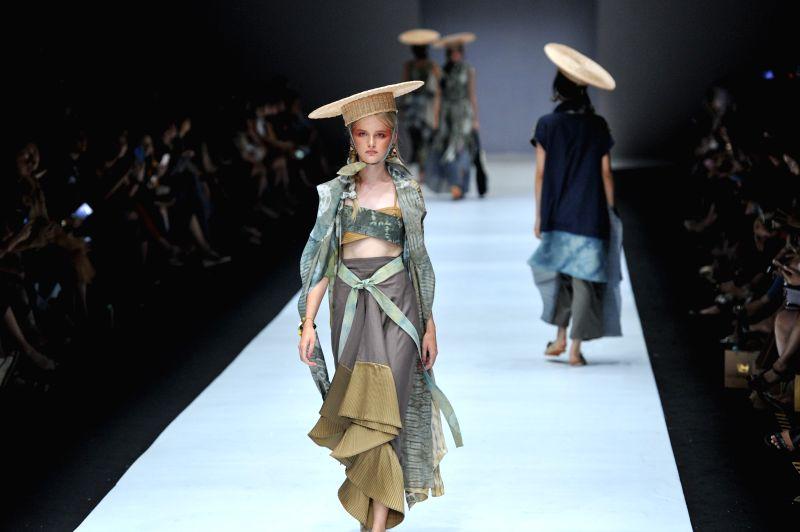 JAKARTA, Oct. 25, 2018 - A model presents creation design by Humbang Shibori and Purana during Jakarta Fashion Week in Jakarta, Indonesia, Oct. 25, 2018.