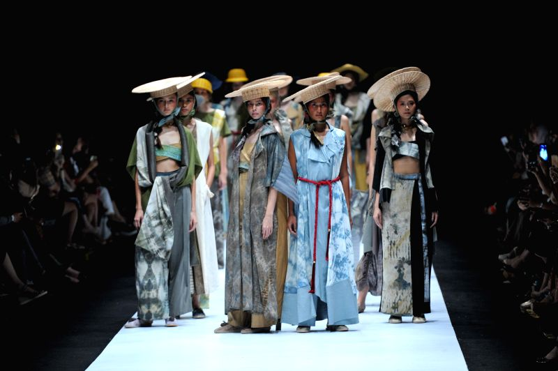 JAKARTA, Oct. 25, 2018 - Models present creation design by Humbang Shibori and Purana during Jakarta Fashion Week in Jakarta, Indonesia, Oct. 25, 2018.