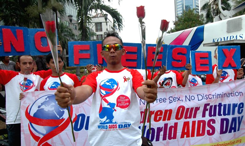 People participate in the commemoration of World AIDS Day in Jakarta, Indonesia, Dec. 1, 2014.