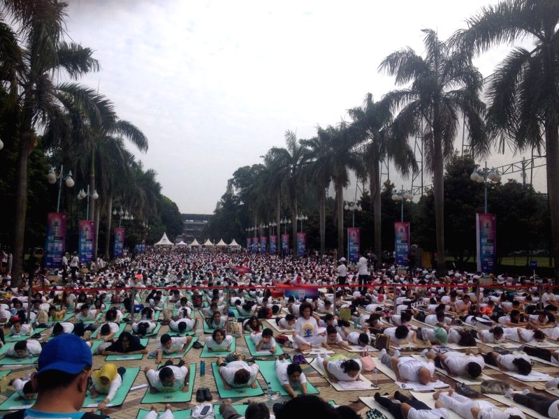 People perform Yoga on International Yoga Day in Jakarta, Indonesia on June 21, 2015.