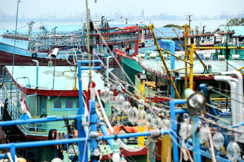 Photo taken on Dec. 2, 2014 shows fishing boats anchored at Muara Baru fishing port in Jakarta, Indonesia. The Ministry of Marine and Fishery suspended the licenses of fishing vessels with ..