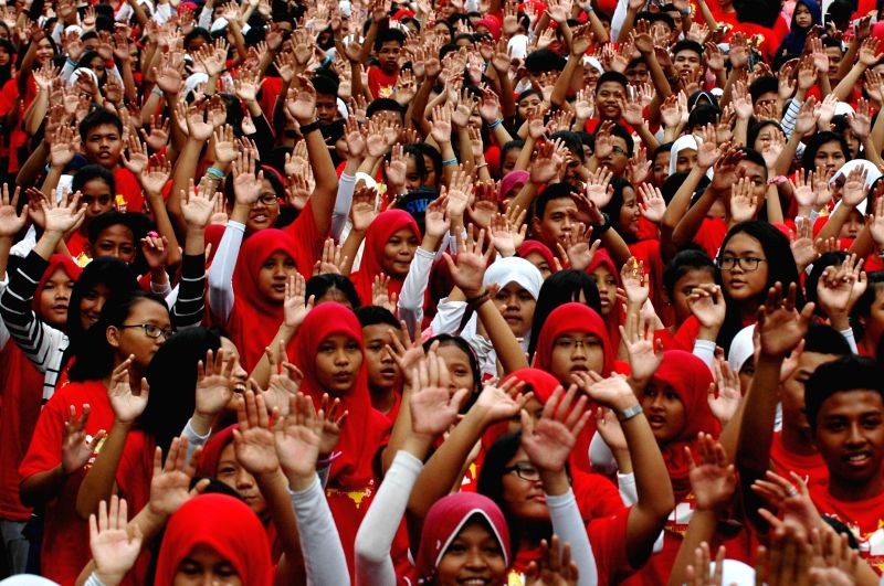 Students dance during the event of HIV/AIDS education in Jakarta, Indonesia, Dec. 7, 2014. The event was held to educate people to prevent the spread of HIV/AIDS. (Xinhua/Agung Kuncahya ...
