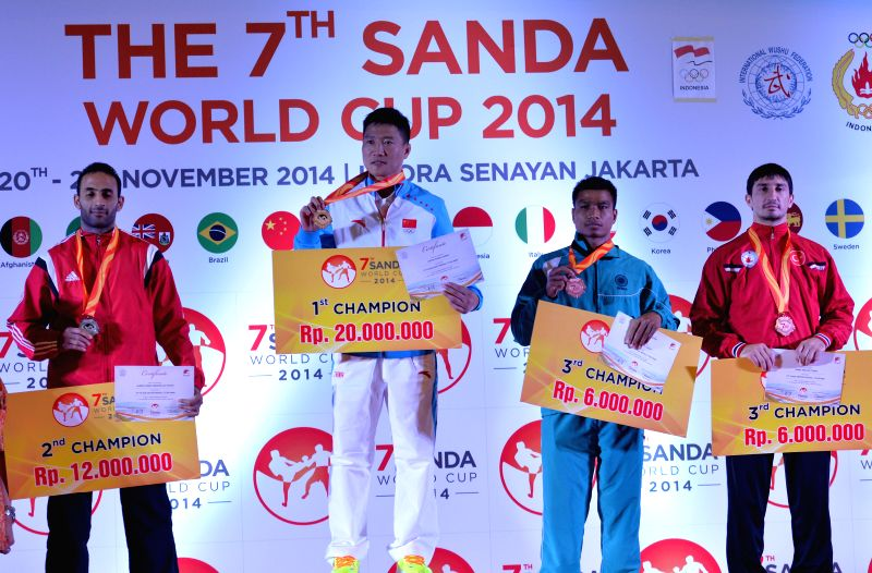 Zhang Kaiyin (2nd L) of China poses for photograph during the awarding ceremony of the Men's Sanda-75kg during the 7th Sanda World Cup in Jakarta, Indonesia, Nov. 21, 2014. Zhang Kaiyin won .