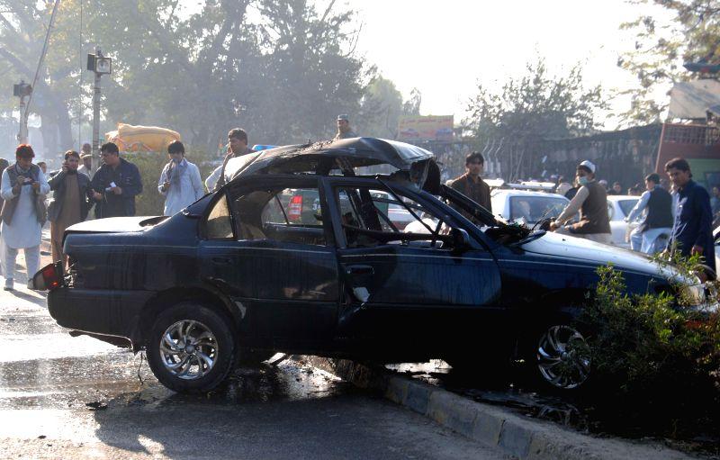 Afghan security forces inspect the site of blast in Jalalabad, Nangarhar province, east Afghanistan, on Nov. 22, 2014. A bomb blast rocked Jalalabad city, the capital of Nangarhar ...