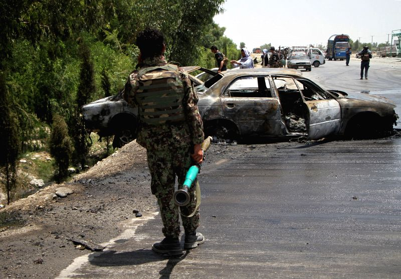 JALALABAD, July 10, 2018 - Afghan security force members inspect at the site of a blast in Nangarhar province, Afghanistan, July 10, 2018. Eight civilians and two security force members were killed ...