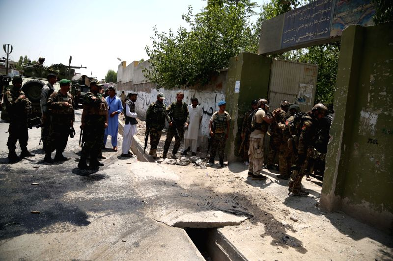 JALALABAD, July 11, 2018 - Afghan security force members inspect the site of an attack in Jalalabad, Nangarhar province, Afghanistan, July 11, 2018. Up to 11 people were confirmed dead and 10 others ...