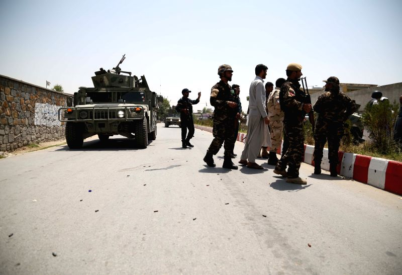 JALALABAD, July 11, 2018 - Afghan security force members stand at the site of an attack in Jalalabad, Nangarhar province, Afghanistan, July 11, 2018. Up to 11 people were confirmed dead and 10 others ...