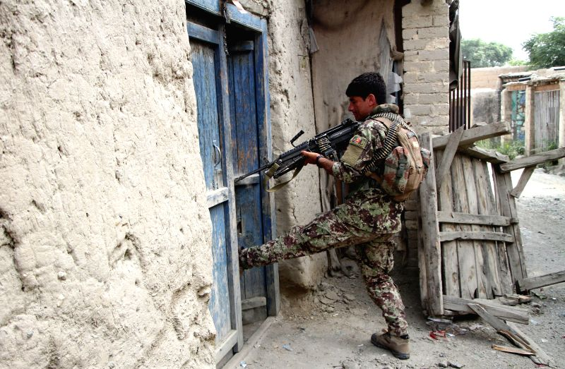 JALALABAD, July 26, 2016 - A soldier takes part in a military operation against the Islamic State (IS) in Kot district of Nangarhar province, Afghanistan, on July 26, 2016. Militants loyal to the ...
