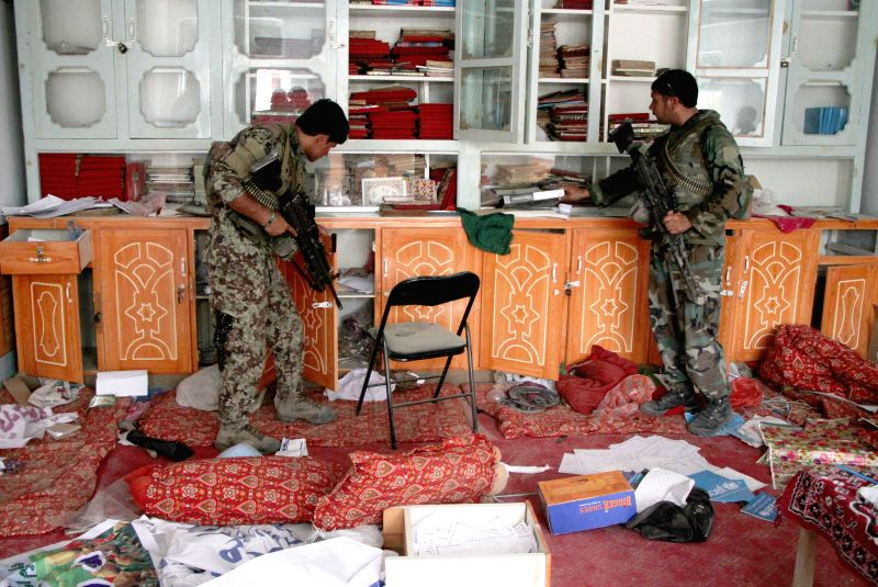 JALALABAD, July 26, 2016 - Soldiers search an office during a military operation against the Islamic State (IS) in Kot district of Nangarhar province, Afghanistan, on July 26, 2016. Militants loyal ...