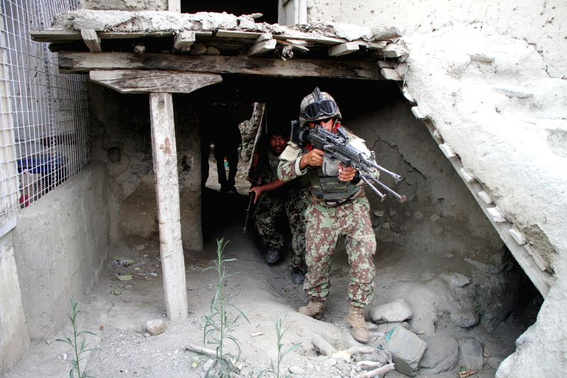 JALALABAD, July 26, 2016 - Soldiers take part in a military operation against the Islamic State (IS) in Kot district of Nangarhar province, Afghanistan, on July 26, 2016. Militants loyal to the ...