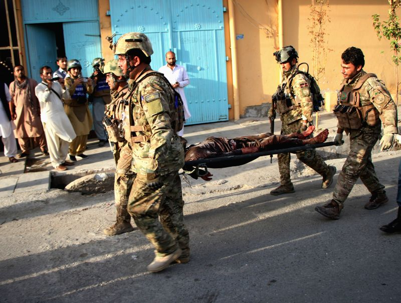 JALALABAD, July 29, 2018 - Afghan security force members carry the body of a victim from the attack site in the eastern Afghan city of Jalalabad, the capital city of Nangarhar province, July 28, ...