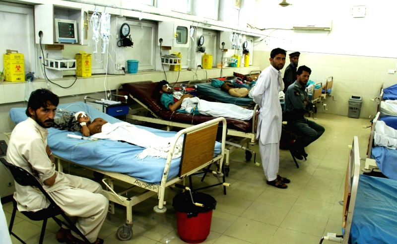 Injured people receive treatment at a local hospital in Jalalabad city, capital of eastern Afghan province of Nangarhar, June 1, 2015. Five militants were killed ...
