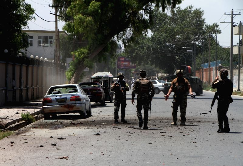 JALALABAD, June 11, 2018 - Afghan security force members inspect the site of an attack in Jalalabad city, capital of Nangarhar province, Afghanistan, June 11, 2018. Four attackers have been killed as ...