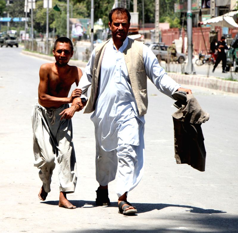 JALALABAD, May 17 Afghan men evacuate from the site of an attack in Jalalabad city, Nangarhar province, Afghanistan, May 17, 2017. At least four people including three attackers were ...