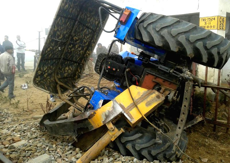 A damaged tractor at the accident area which was hit by a train at a railway crossing in Jalandhar on Jan 3, 2015.