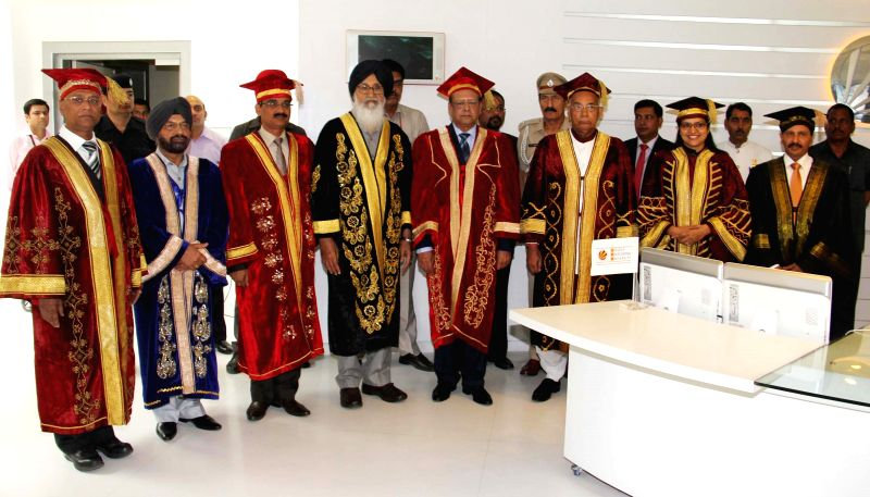 Mauritian President Rajkeswur Purryag the convocation of a private university in Jalandhar on April 20, 2015. Also seen Punjab Chief Minister Parkash Singh Badal, Punjab and Haryana ...