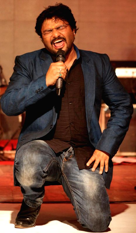 Union MoS for Urban Development and singer Babul Supriyo performs during a college programme in Jalandhar, Punjab on March 19, 2015.