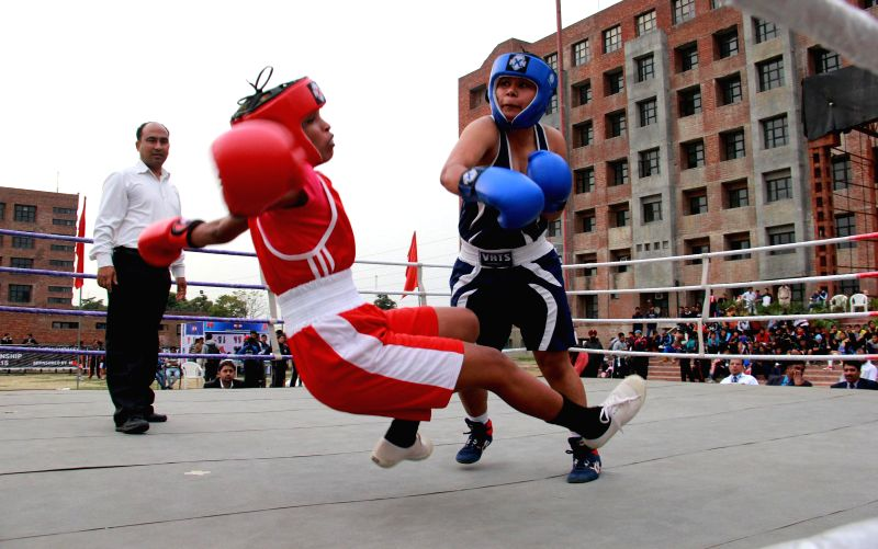 Women Boxing players in action during an All India Inter University Women Boxing Championship - 2015 match in Jalandhar on Feb 20, 2015.