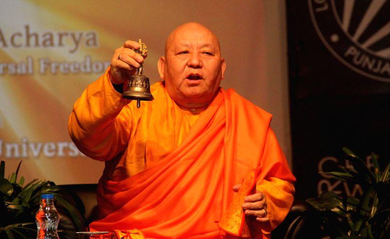 World renowned Philosopher Master Guru Karma Acharya preaches students at a private university in Jalandhar on Jan 22, 2015.