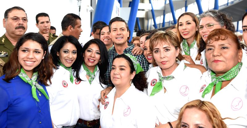 Image provided by Mexico's Presidency, of Mexican President, Enrique Pena Nieto (C), posing with women of the peasant union, during the closing ceremony of the ...