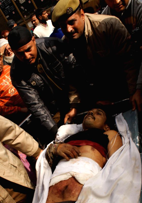 A civilian injured in a fierce gun battle between the security forces and militants near the international border in Jammu and Kashmir being shifted taken to Government Medical College for ...