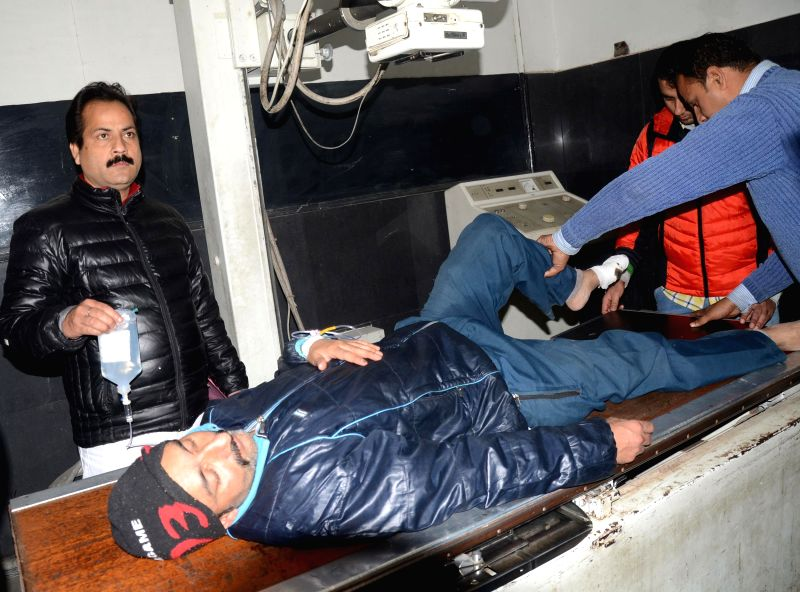 A civilian injured in heavy firing by the Pakistani Rangers in the Arnia sector at the international border of Jammu and Kashmir being admitted at the government hospital in Jammu on Jan. 30, .