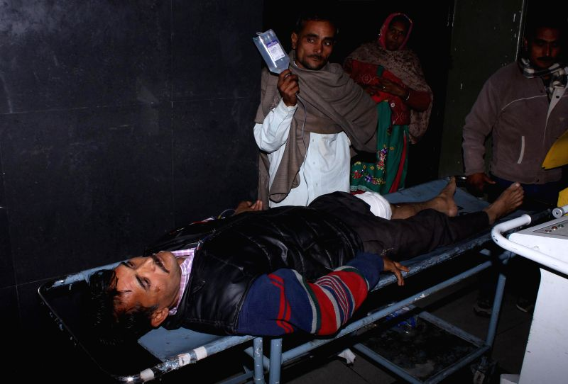 An injured civilian at Government Medical College Hospital in Jammu on Jan 3, 2015. Six civilians were injured due to Pakistani shelling on the international border in Jammu and Kashmir`s ...