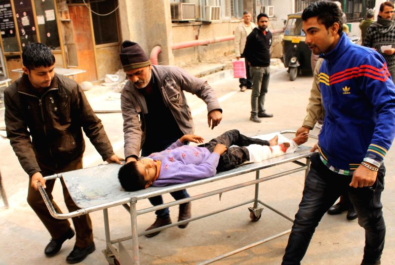 An injured civilian is taken to Government Medical College Hospital in Jammu on Jan 3, 2015. Six civilians were injured due to Pakistani shelling on the international border in Jammu and ...