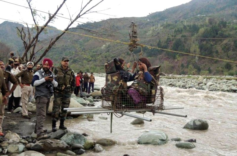 Jammu and Kashmir : Army personnel carry out rescue operation in flood hit Jammu and Kashmir on March 31, 2015.