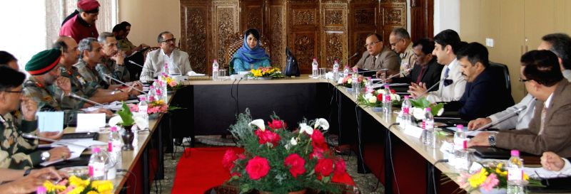 Jammu and Kashmir Chief Minister Mehbooba Mufti and Deputy Chief Minister Nirmal Singh during a Unified Headquarters (UHQ) meeting in Srinagar, on May 10, 2016. - Mehbooba Mufti and Nirmal Singh