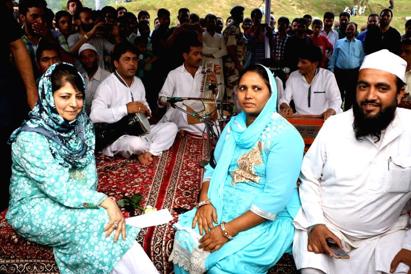 "Jammu and Kashmir Chief Minister Mehbooba Mufti with Gujarati tourists during ""Kashmir  Flower Festival"" at Botanical Garden in Srinagar, on May 22, 2016. - Mehbooba Mufti"