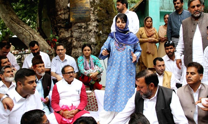 "Jammu and Kashmir Chief Minister Mehbooba Mufti and Deputy Chief Minister Nirmal Singh open ""Baitul Zaireen"" for devotees at Shahdra Sharif in Jammu and Kashmir's Rajouri ... - Mehbooba Mufti and Nirmal Singh"