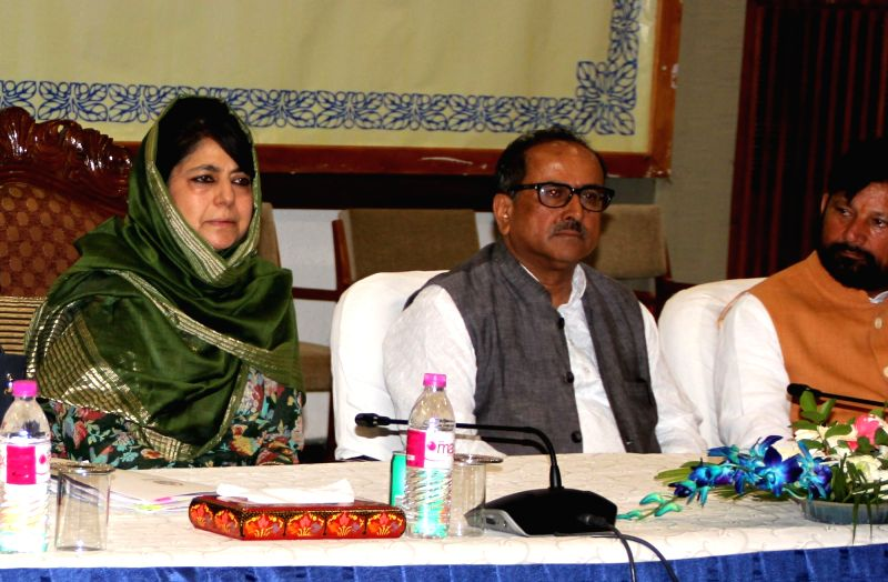 Jammu and Kashmir Chief Minister Mehbooba Mufti chairs an all party meet regarding the recent Kashmir violence in Srinagar on July 21, 2016. Also seen Jammu and Kashmir Deputy Chief ... - Mehbooba Mufti and Nirmal Kumar Singh