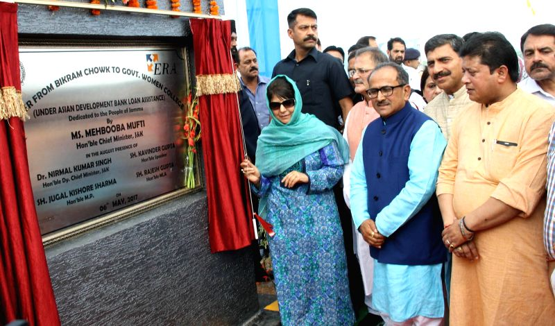Jammu and Kashmir Chief Minister Mehbooba Mufti and Deputy Chief Minister Nirmal Singh inaugurate a flyover project in Jammu on May 6, 2017. - Mehbooba Mufti and Nirmal Singh