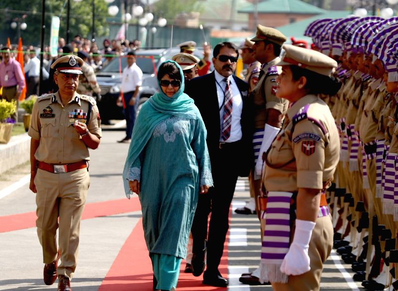 Jammu and Kashmir Chief Minister Mehbooba Mufti inspects guard of honour in the lawns of civil secretariat in Srinagar on May 8, 2017. - Mehbooba Mufti