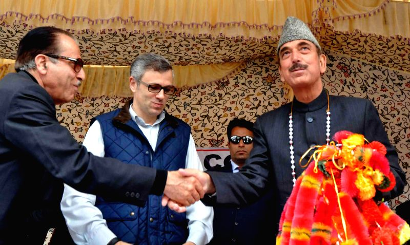 Jammu and Kashmir Chief Minister Omar Abdullah and Congress leader Ghulam Nabi Azad during an election rally at Verinag in Anantnag district of Jammu and Kashmir on April 21, 2014.