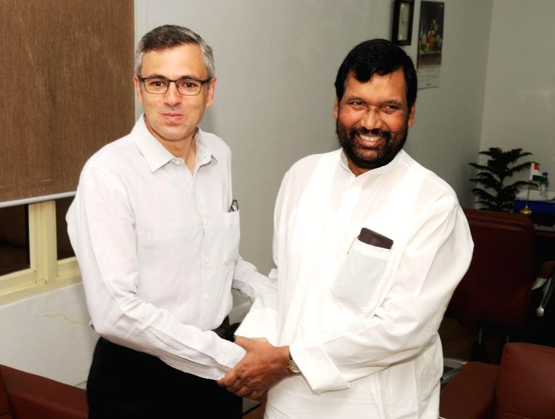 Jammu and Kashmir Chief Minister Omar Abdullah and Union Minister for Consumer Affairs, Food and Public Distribution Ramvilas Paswan during a meeting in New Delhi on July 9, 2014.