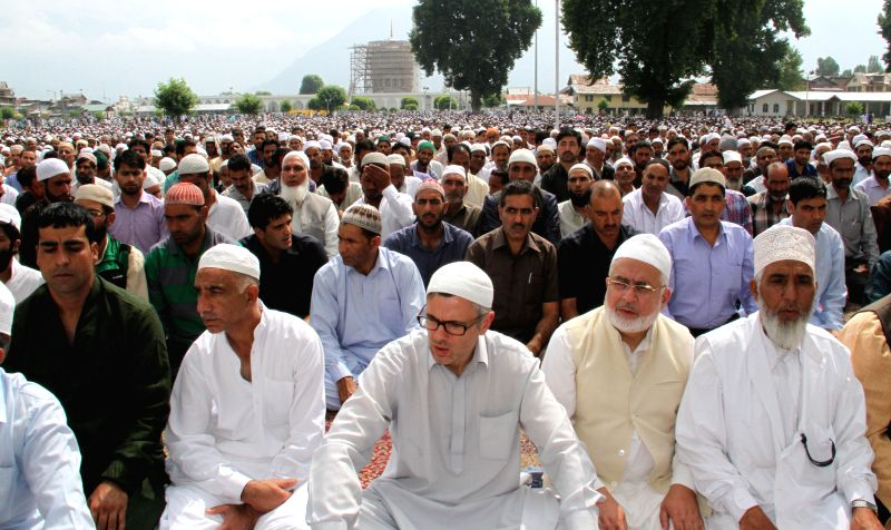 Jammu and Kashmir Chief Minister Omar Abdullah offering prayers at Dargah Hazratbal on ocassion of EId ul Fitr in Srinagar on July 29, 2014.